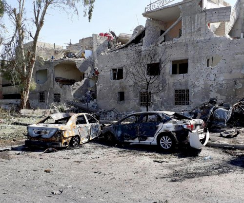At least 18 dead in trio of car bombings in Damascus