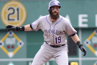 Rookies help Colorado Rockies defeat Cincinnati Reds to start homestand