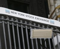 Dow rises 306 points; tech stocks drag S&P 500, Nasdaq lower
