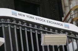 Dow rises 306 points; tech stocks drag S&P 500, Nasdaq lower