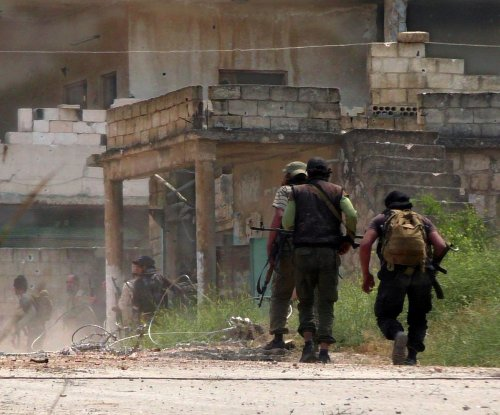 Rebels make gains in Syria, capture army base