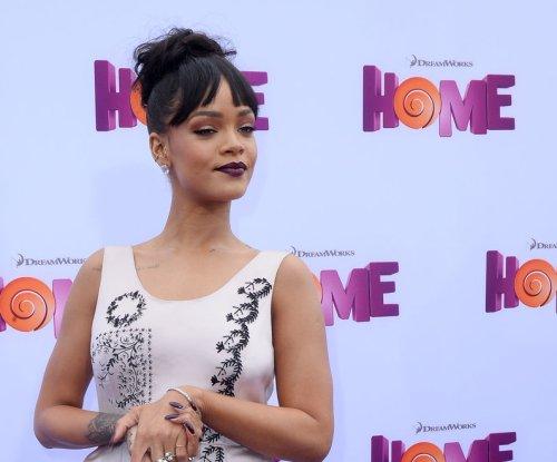 Rihanna sparks dating rumors while partying at Barbados carnival