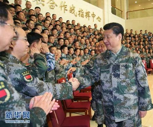 Chinese President Xi Jinping takes title of commander in chief