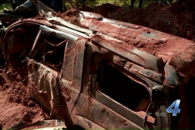 Plastic-wrapped SUV found buried behind Oklahoma home