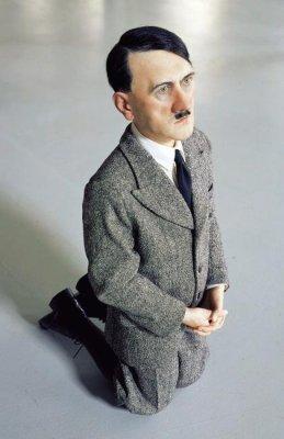 Praying Hitler statue placed in Warsaw Jewish ghetto
