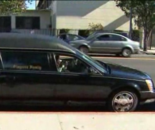 Hearse stolen from church with body inside