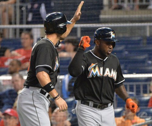 Marcell Ozuna, Justin Bour homers help Miami Marlins top Philadelphia Phillies