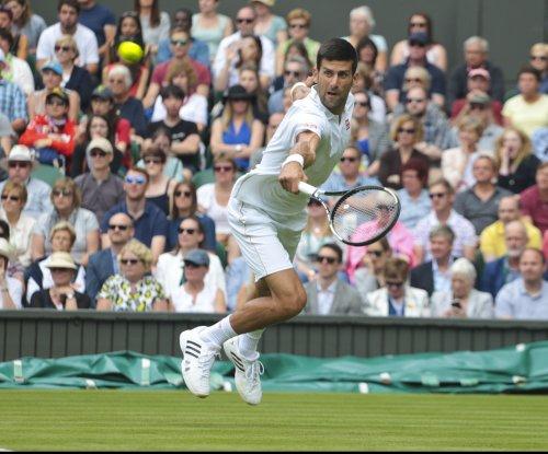 Novak Djokovic begins Wimbledon defense with easy win