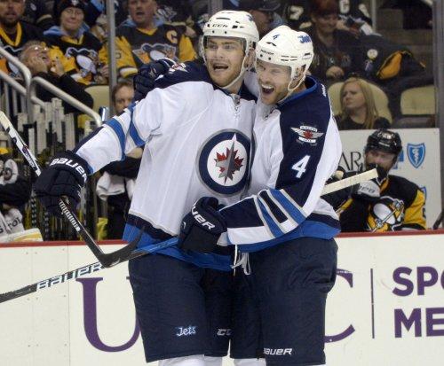 Winnipeg Jets rally from two down to beat Anaheim Ducks in OT