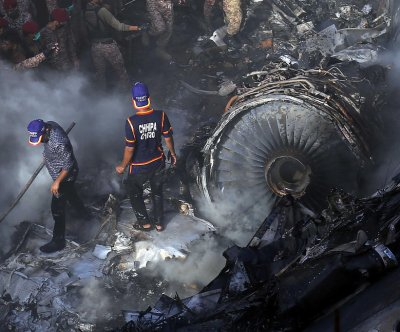 Pakistan officials finish identifying victims of PK-8303 crash