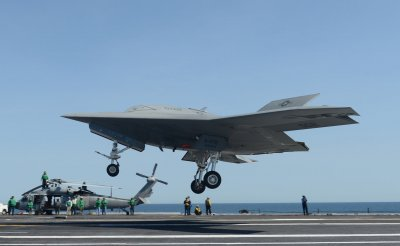 Unmanned X-47Bs tested on USS Theodore Roosevelt