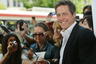 'Rewrite' star Hugh Grant to selfie-seeking fans: How about a chat?
