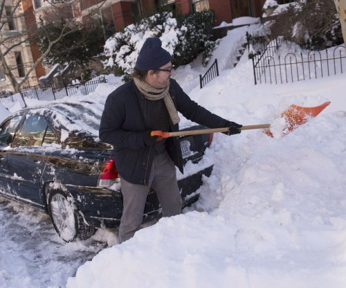 Federal, state governments, schools closed amid snowstorm cleanup