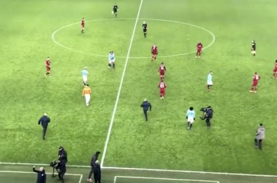 Manchester City security think player is pitch invader, chase him down