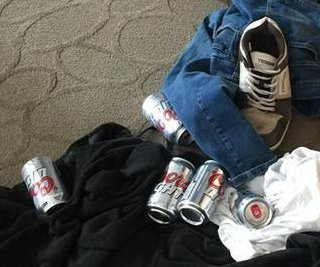 WestJet passenger finds mystery clothing, beer in her luggage
