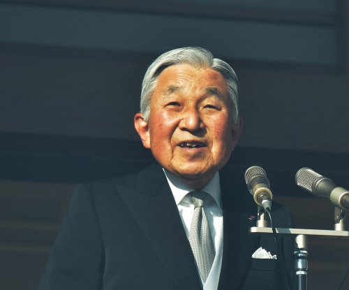 Japan's Diet enacts law allowing emperor to abdicate
