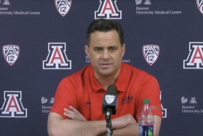 Arizona's Miller remains coach, says he has never paid recruit