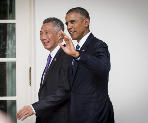 Singapore PM joins with Obama to push for TPP; calls trade deal a 'litmus test' of 'credibility and seriousness'