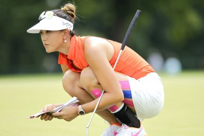 Michelle Wie takes two-shot lead in Singapore