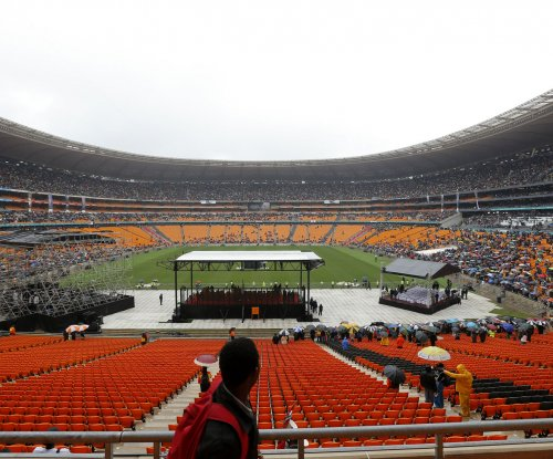 2 fans killed in stampede at Soweto derby soccer match in South Africa