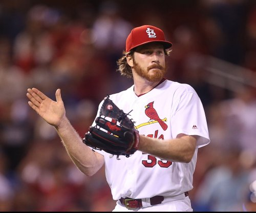 Cardinals face Reds after managerial change