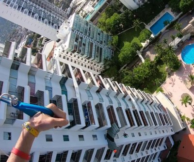 BASE jumper who crashed into hotel rescued by woman on balcony