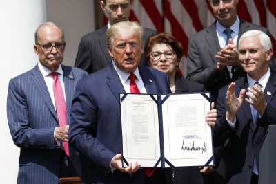 Trump signs law loosening Paycheck Protection Program limits