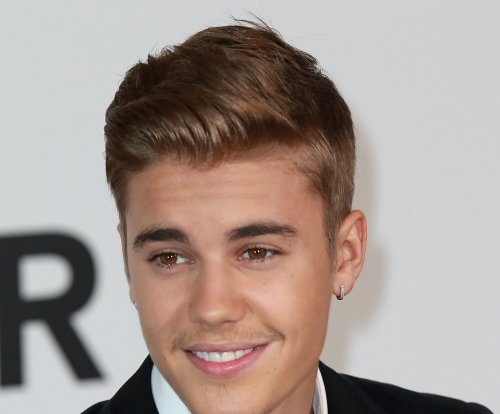 Justin Bieber crashes high school prom