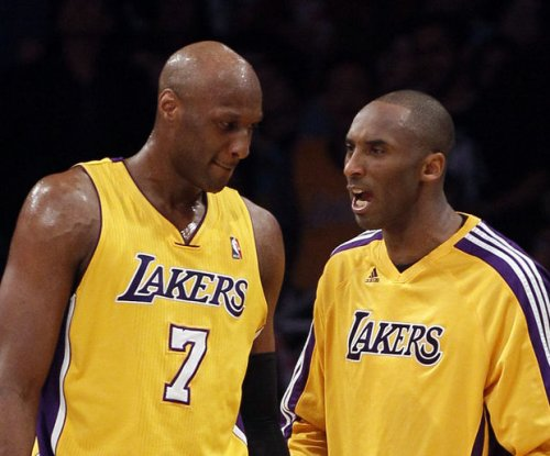 Kobe Bryant rushes to Lamar Odom's bedside