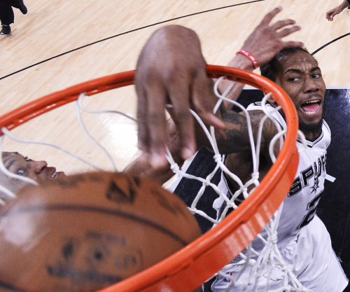San Antonio Spurs coach Gregg Popovich: Kawhi Leonard progressing slowly