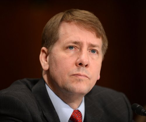 First chief of U.S. consumer watchdog agency to resign this month