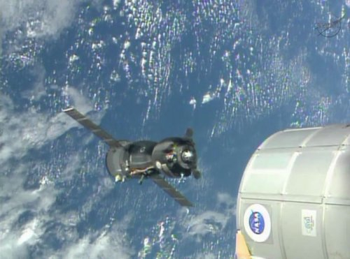 Soyuz changes parking spots at space station, making way for new crew