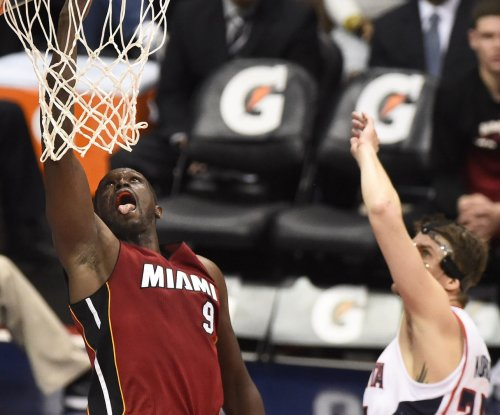 Luol Deng, Miami Heat overpower Charlotte Hornets in opener