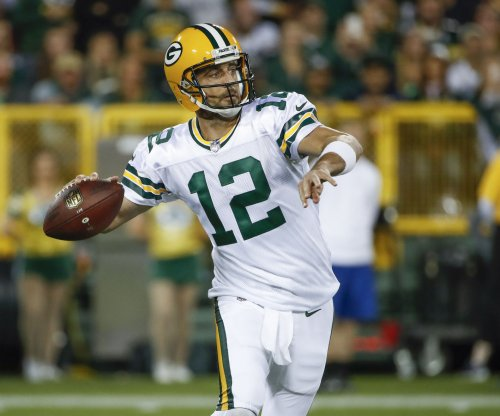 Aaron Rodgers: Green Bay Packers coach Mike McCarthy calls hit 'unnecessary'