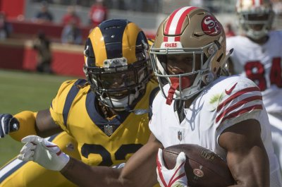 Niners lose RB Mostert to broken arm