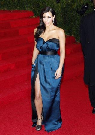 Kim Kardashian steps out in tiny white bikini during second honeymoon in Mexico