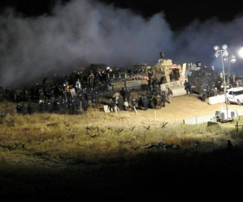 Police respond to 'riots' at Dakota Access pipeline; protesters report tear gas