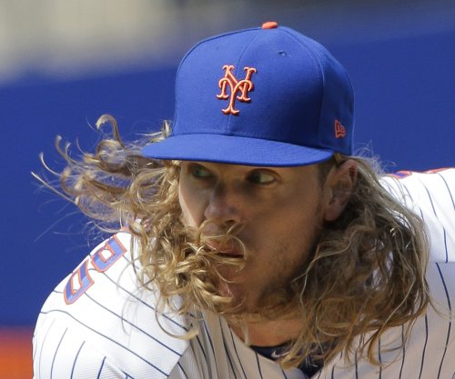New York Mets' Noah Syndergaard leaves game with elbow injury