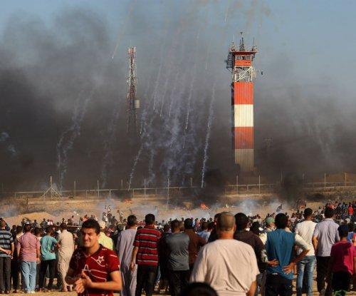 Palestinian teen dies, IDF officer injured in Gaza protests