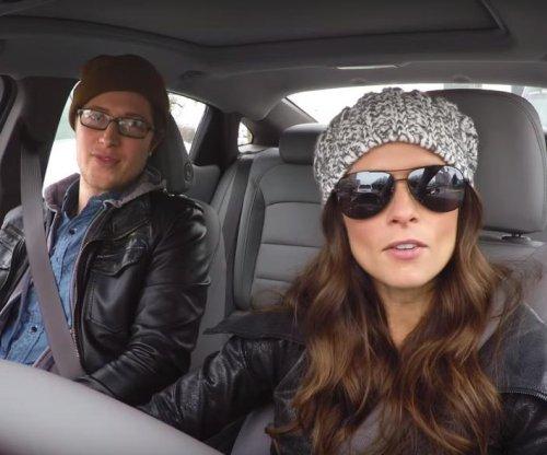 Danica Patrick poses as Lyft driver