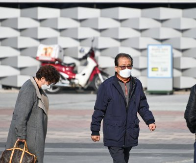 South Korea coronavirus cases near 1,000; 10 dead