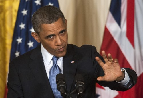 Obama: IRS actions 'outrageous'; Benghazi controversy 'sideshow'