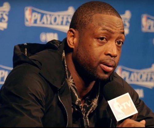 Toronto Raptors top Miami Heat in OT despite guards' woes