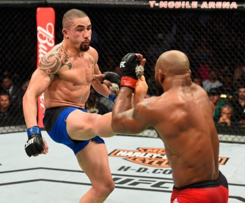 UFC 213 results: Robert Whittaker fights through leg injury to win interim middleweight title