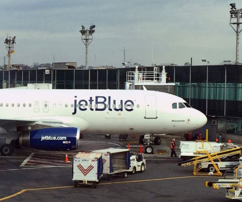 Police surround JetBlue flight at NYC's JFK Airport after false hijack alarm