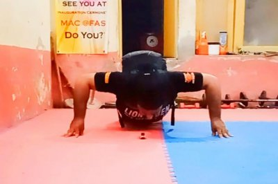 Martial artist breaks pushup Guinness record while wearing 60 pounds