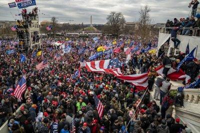 Capitol riots: Police arrest man carrying Pelosi's lectern