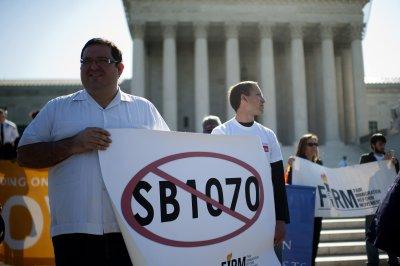 Court guts Arizona immigration law