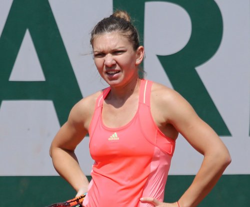 Halep stunned at French Open; Sharapova into 3rd round
