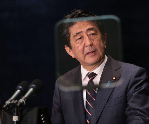 Japan's Shinzo Abe criticizes military's chauvinistic male culture